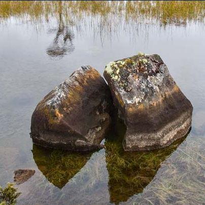 beneath a reflective surface